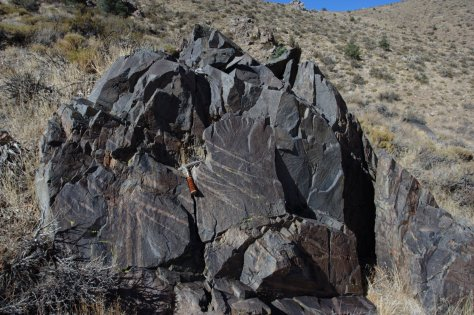 Hammer for scale rests on a silicic dike in the Benton Range, near Bishop, CA.  Image credit: Bill Mitchell.