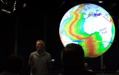 An educator from the Denver Museum of Nature and Science presents about sea floor spreading at the Science on a Sphere network meeting in Long Beach, CA (2012).  Image credit: Bill Mitchell.