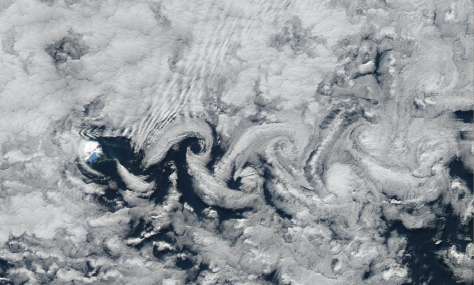Gravity waves and Von Karman vortices at Heard Island, May 1, 2015.  Resolution is 250 m/pixel.  Image credit: NASA Aqua/MODIS.