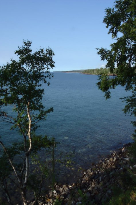 A clear morning on Lake Superior.  The lava flows making up the points further down the shore can be seen dipping gently toward the lake.  Image credit: Bill Mitchell (CC-BY).