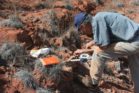 Recording rock core orientation for paleomagnetic analysis.  Image credit: Bill Mitchell.