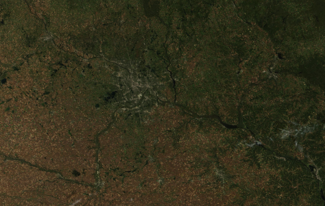 Minneapolis area seen by NASA's Terra satellite Sept. 30, 2015.  The Minneapolis and St. Paul airport is the concrete-colored smudge just left of center; St. Cloud is in the upper left, Winona toward the bottom right, and at furthest bottom right is La Crosse, WI.  Image credit: NASA (public domain).