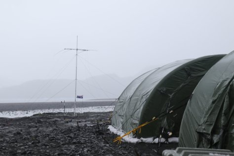 Camp seen on a rainy, dreary day typical of Heard Island.  Image credit: Bill Mitchell (CC-BY).