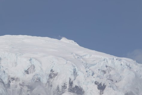 Mawson Peak with a small plume indicating volcanic activity.  Image credit: Bill Mitchell (CC-BY).