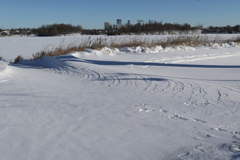 Blowout feature on the leeward side of a lake.